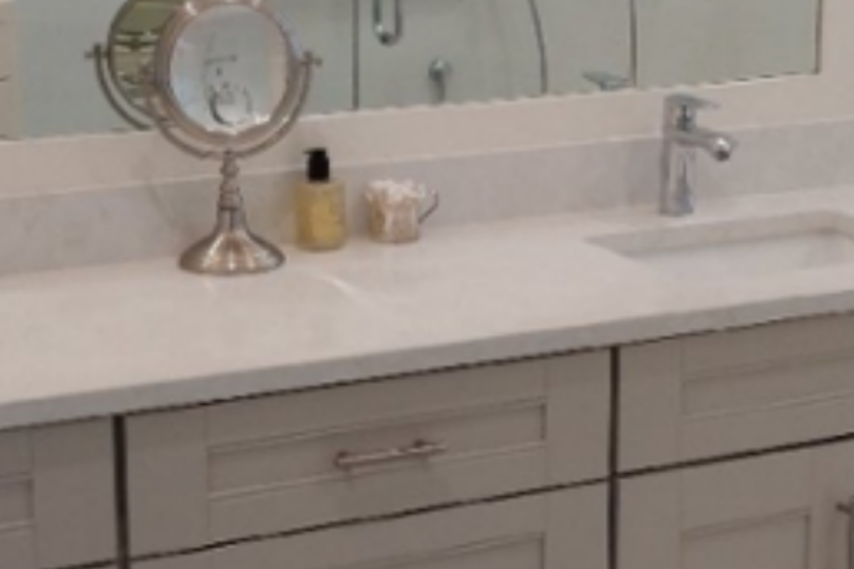 light quartz vanity top with light grey shaker-style cabinets
