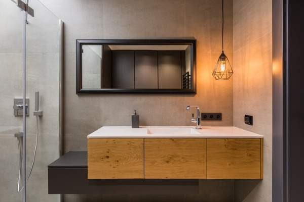 bathroom-with-integral-countertop-sink-picture-id881538638