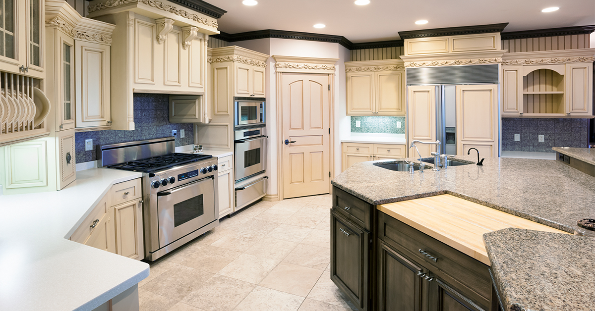 Enormous, brand new remodeled kitchen with off white woodwork.