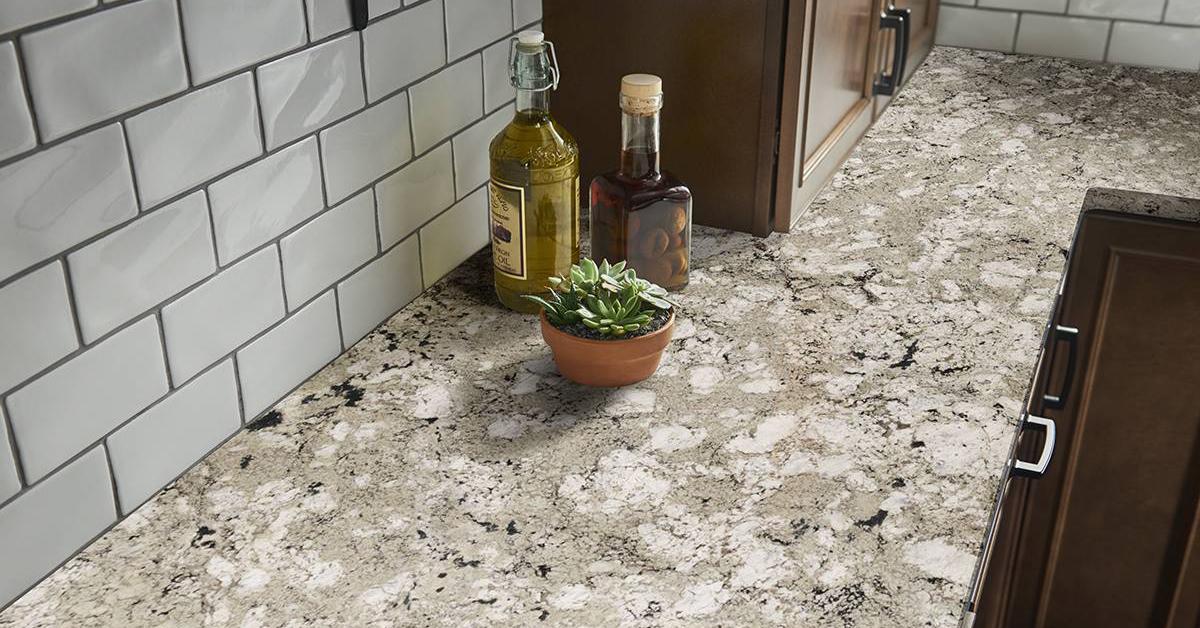 Granite countertop with oil bottles and succulent sitting on top