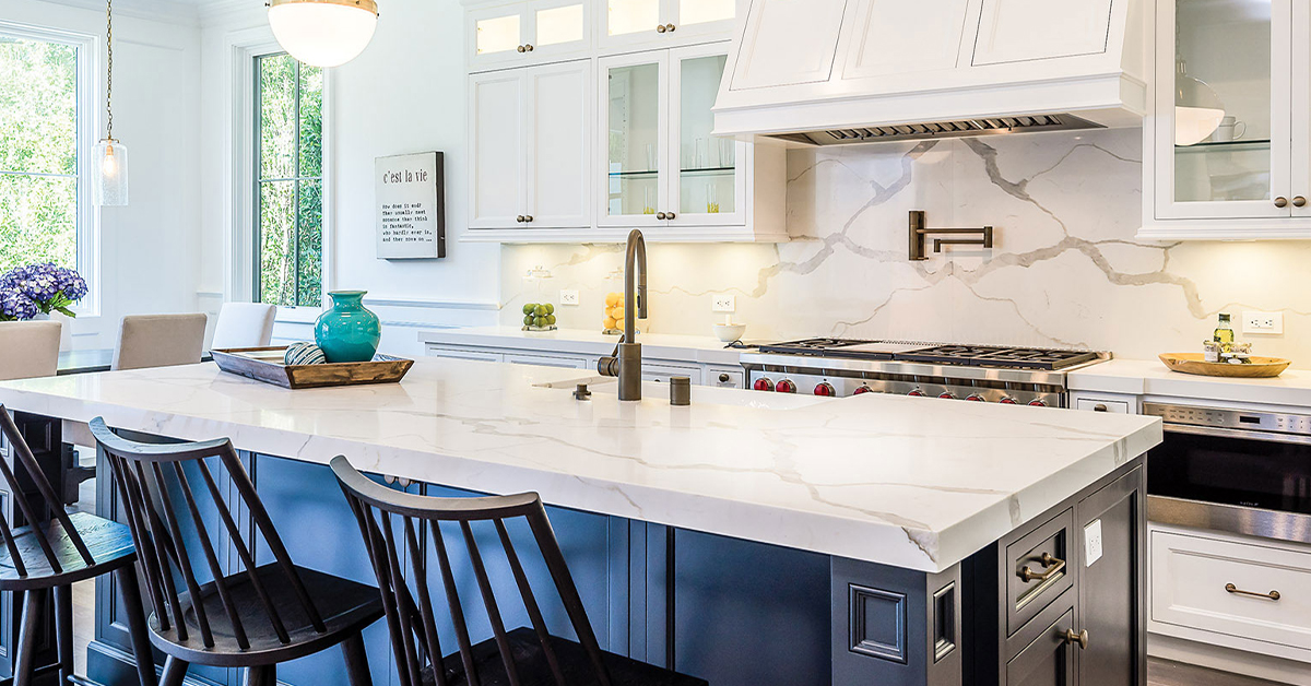 Bright kitchen with white and gray quartz countertops