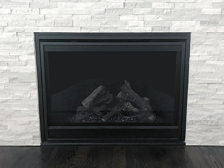 A classy fireplace with white, brick style tile surround