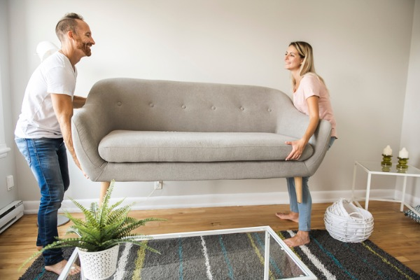 couple rearranging couch