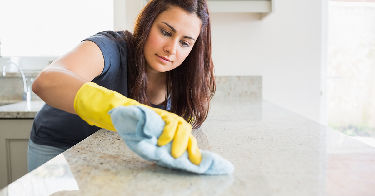 woman-cleaning-countertop